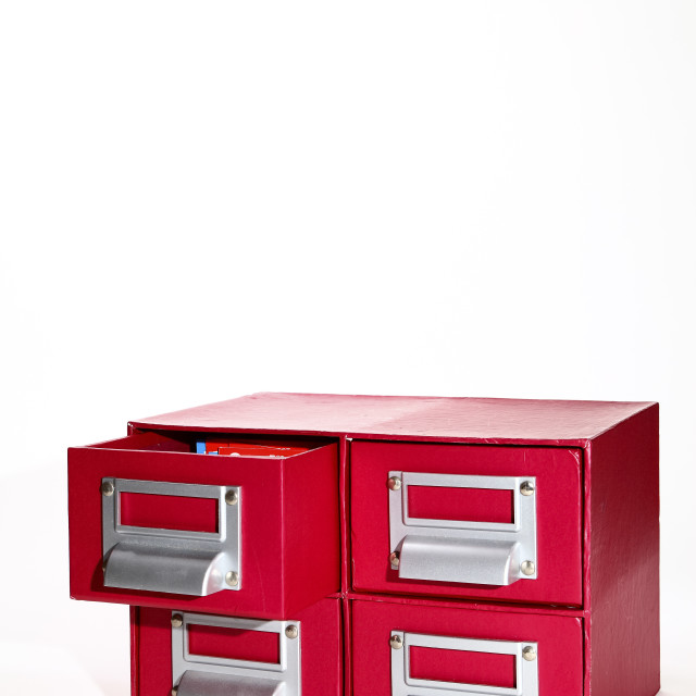 """""""red filing cabinet isolated on a white background"""" stock image"""