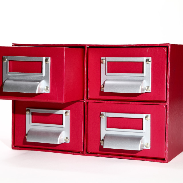 """red filing cabinet isolated on a white background"" stock image"