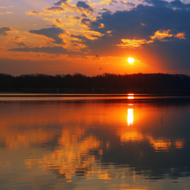 """""""Sunrise over the lake reflected on the water surface"""" stock image"""
