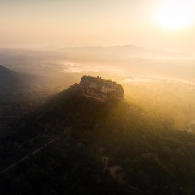 """Sunrise over Sigiriya rock fortress in Sri Lanka aerial view"" stock image"