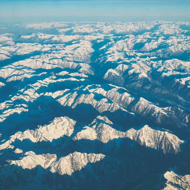 """White pikes in the Alps from airplane at the morning over Italy"" stock image"