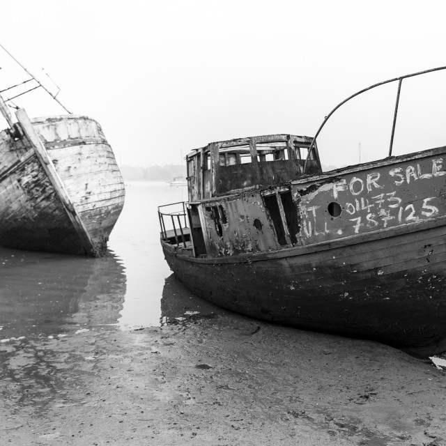 """Wrecks awaiting the tide"" stock image"