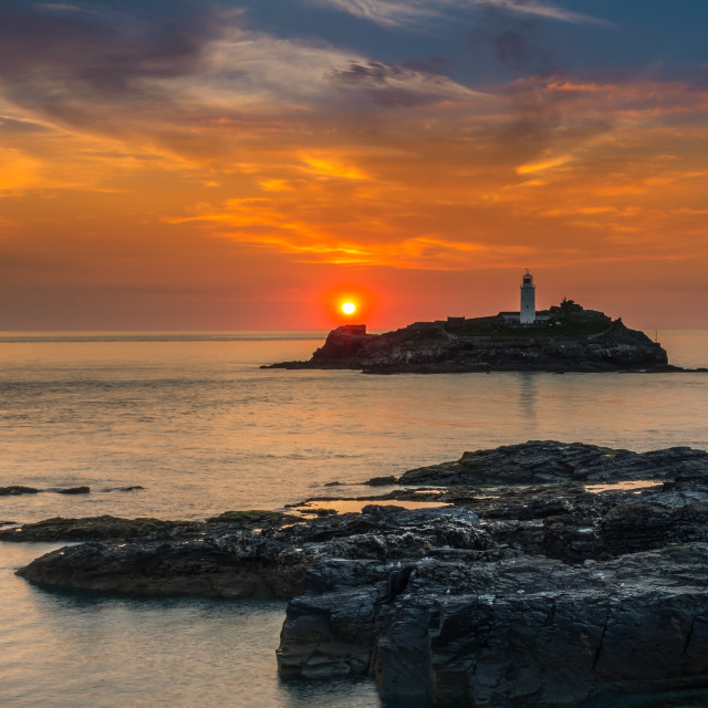 """Sunset at Godrevy Lighthouse"" stock image"