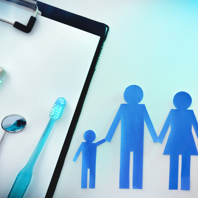 """Family dental insurance on table top with light top"" stock image"