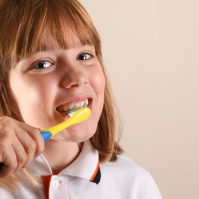 """Little girl cleaning her teeth close up"" stock image"