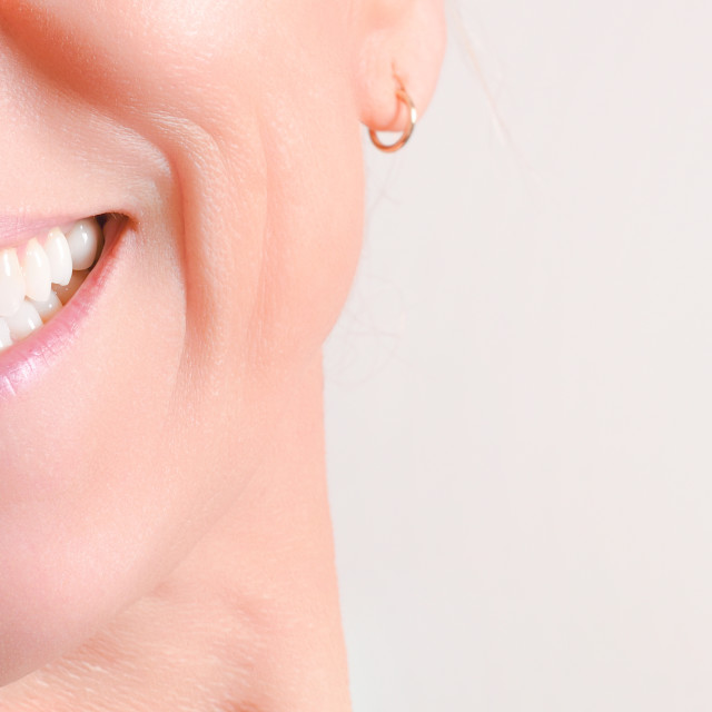 """Mature woman showing perfect natural white teeth in front"" stock image"