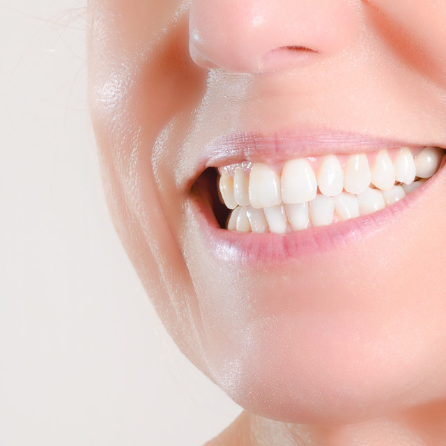 """Mature woman showing perfect natural white teeth on the side"" stock image"