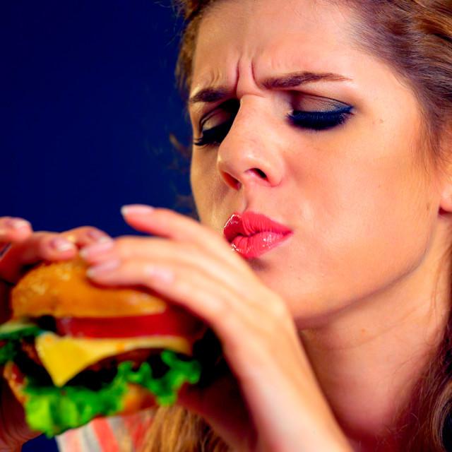 """""""Woman eating unhealthy hamburger junk food"""" stock image"""