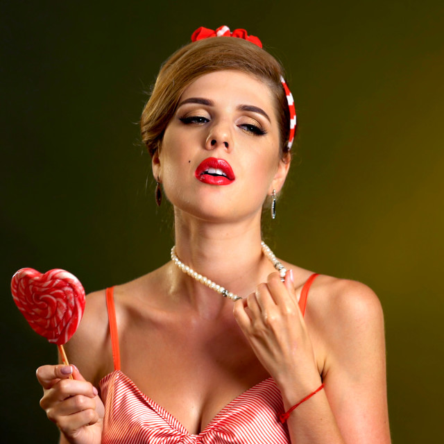 """""""Woman confectioner seller comes up new recipe lollipop"""" stock image"""