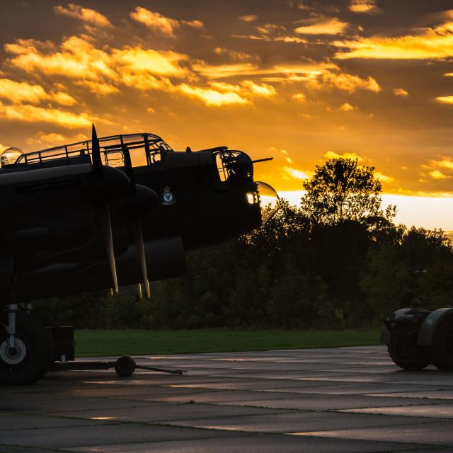 """Lancaster bomber at sunset"" stock image"