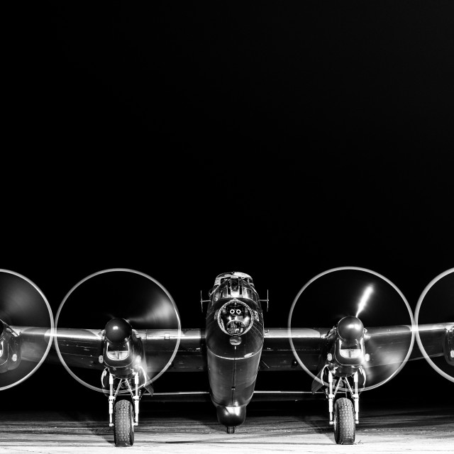 """""""Black and White shot of the Lancaster bomber with engines running"""" stock image"""
