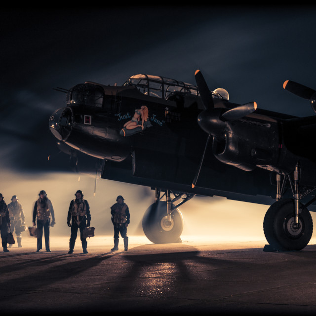 """""""Lancaster bomber and crew at night"""" stock image"""