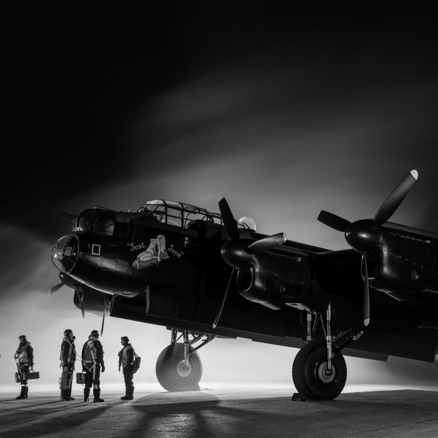 """""""Lancaster bomber with crew in black and white"""" stock image"""