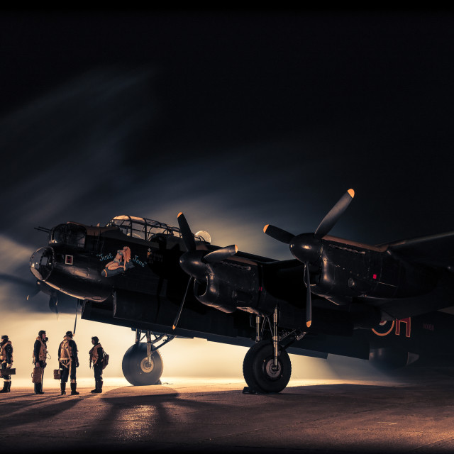 """""""Lancaster bomber with crew at night"""" stock image"""