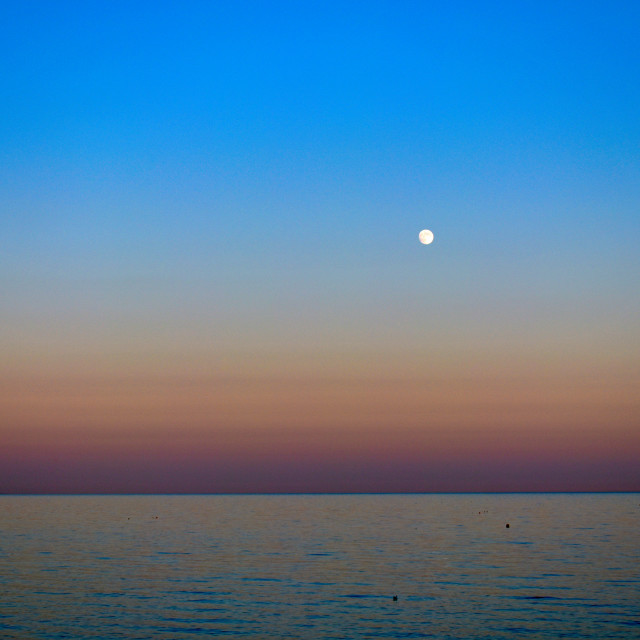 """Calm Sea, Full Moon at Dusk"" stock image"