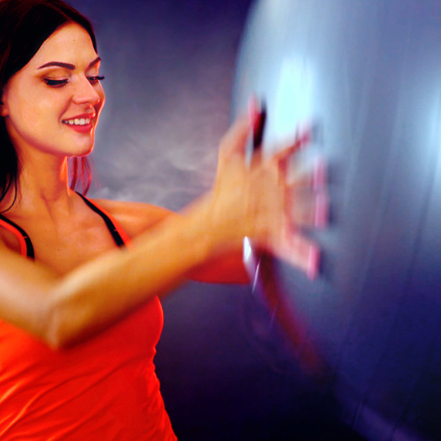 """""""Fitness girl exercising Swiss ball in fitball gym"""" stock image"""