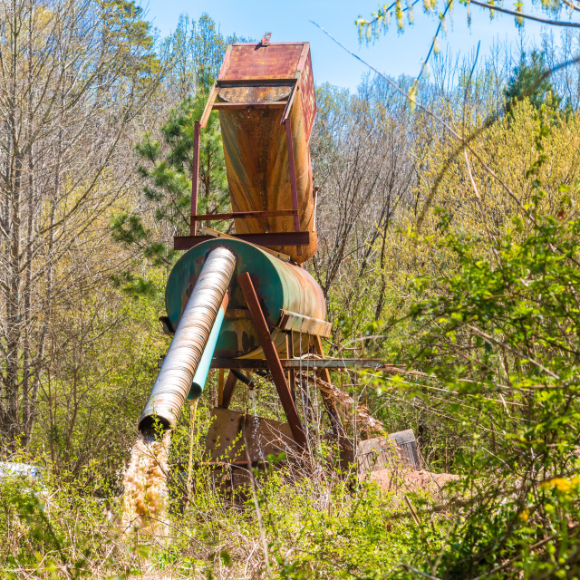 """Dredging Machinery in Forest"" stock image"