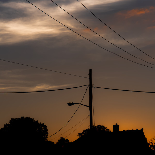 """Sunset sky with power lines"" stock image"