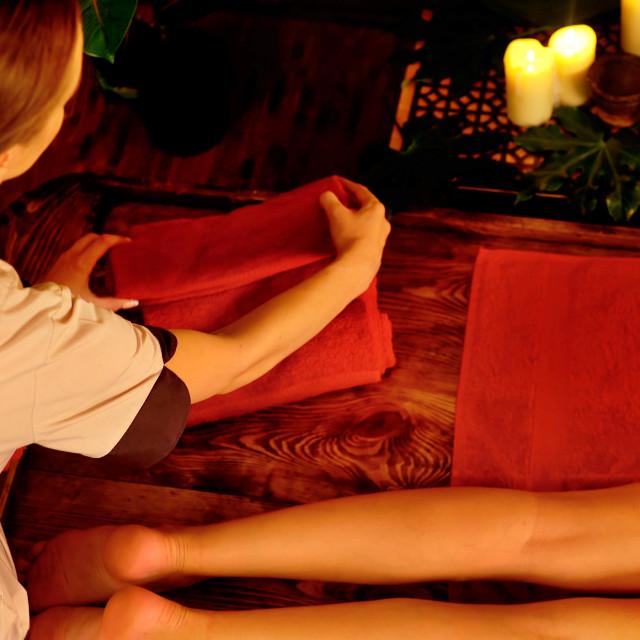 """Foot and leg Asian massage. Cropped shot of foot reflexology"" stock image"