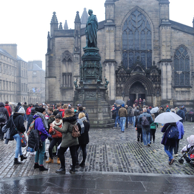 """Tourists in the rain near St Giles Cathedral"" stock image"