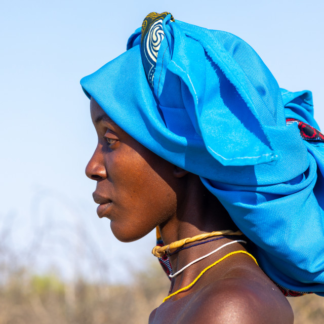 """""""Portrait of a mucubal tribe woman with a blue headwear, Namibe Province,..."""" stock image"""