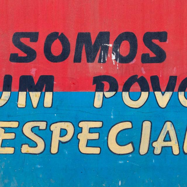 """Patriotic slogan on a wall, Benguela Province, Catumbela, Angola"" stock image"