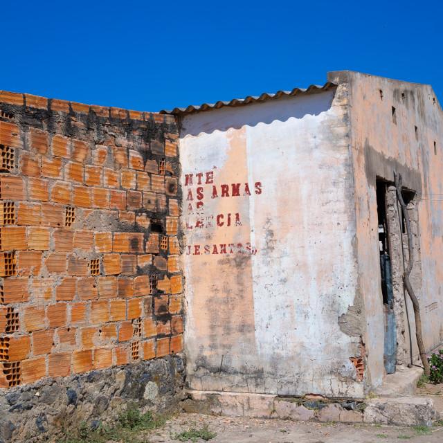 """Old communist propaganda message written on a wall, Cunene Province, Cahama,..."" stock image"