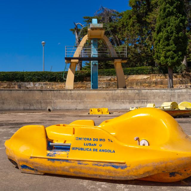 """""""Paddle boat in front of the diving board in piscina da senhora do monte,..."""" stock image"""