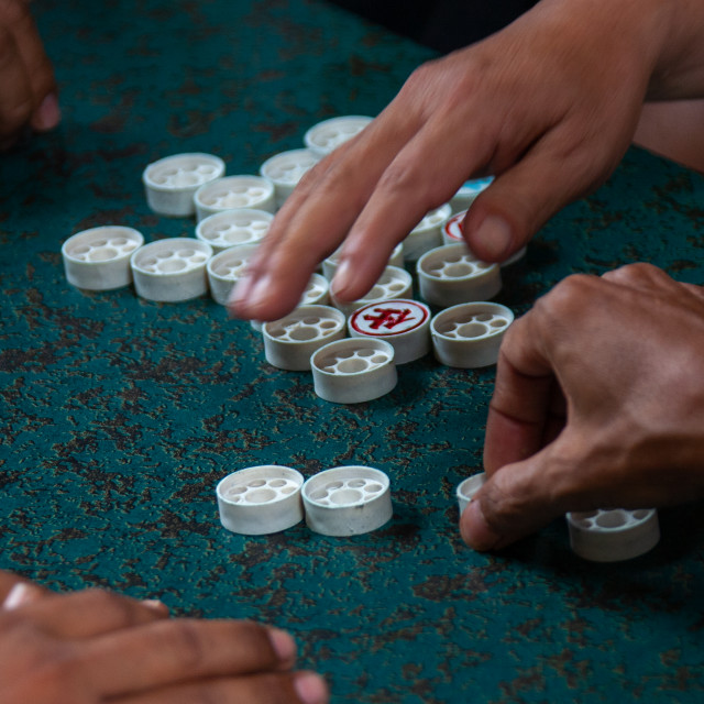 """""""Cambodian men playing board game xiangqi or chinese chess, Phnom Penh..."""" stock image"""