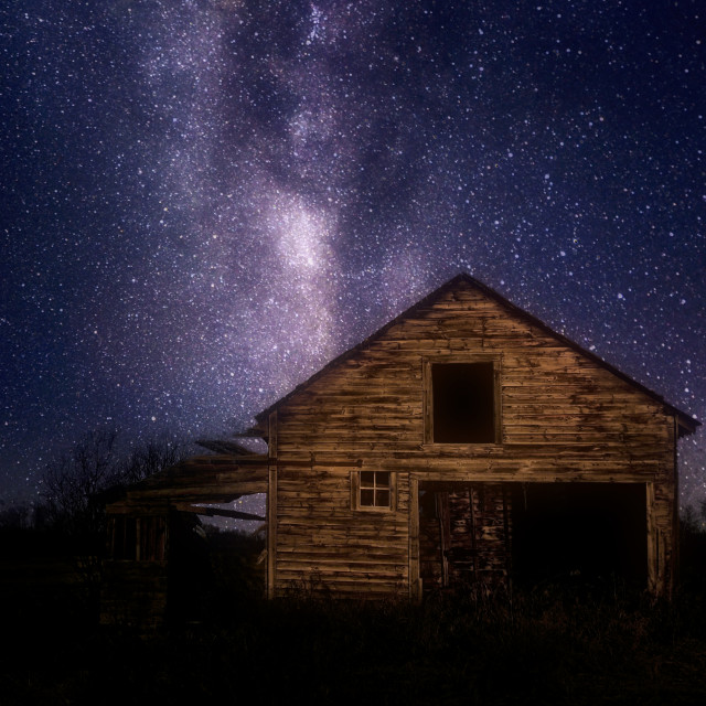 """""""A crumbling wooden car garage under a star filled night sky in a rural landscape"""" stock image"""