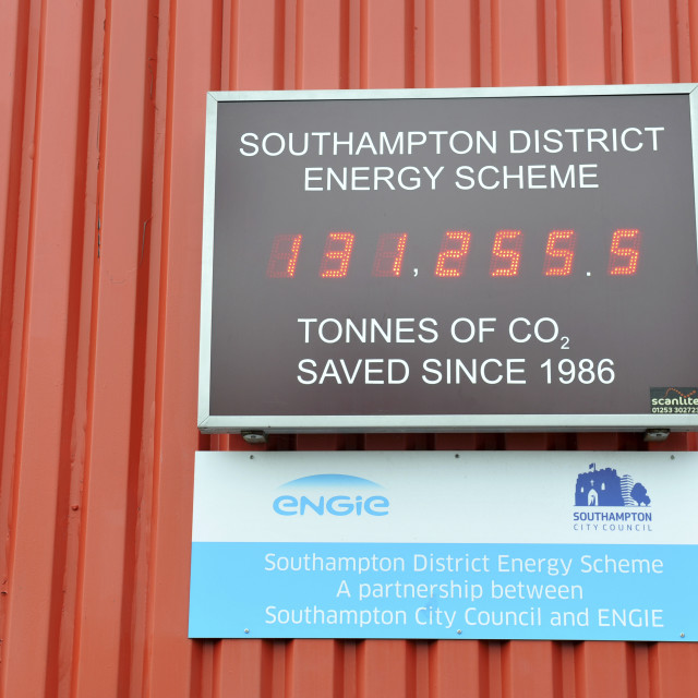"""""""Southampton UK Southampton District Energy Scheme, district geothermal heating and cooling system in the centre of the city. Sign showing the tonnes of Co2 saved since its inception in 1986."""" stock image"""