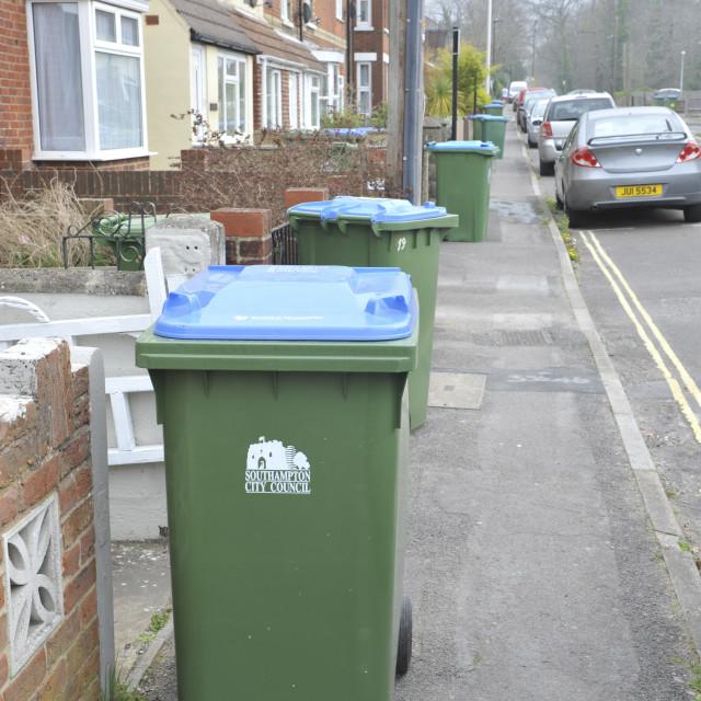 """Southampton UK Huge wheelie bins line a suburban street in Woolston"" stock image"