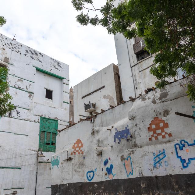 """Space invaders art on the wall of a house, Mecca province, Jeddah, Saudi Arabia"" stock image"
