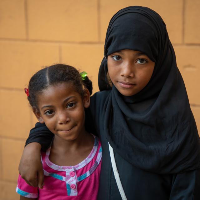 """Portrait of two yemeni refugee girls, Asir province, Muhayil, Saudi Arabia"" stock image"