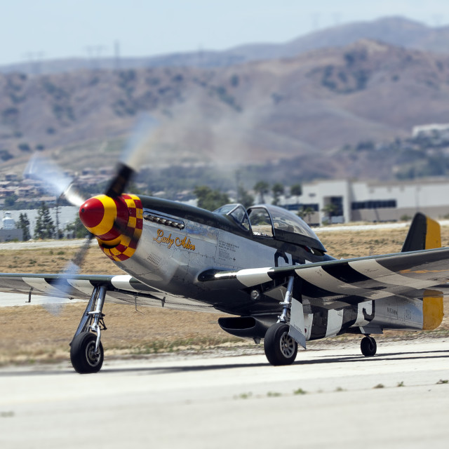 """P-51D Mustang taxiing on the runway"" stock image"