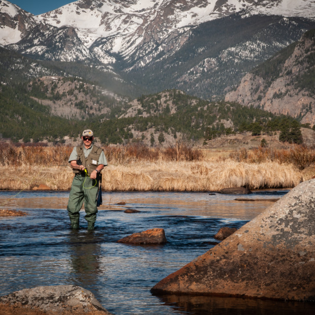 """Fishing the Creek in Rocky Mountain National Park in Estes Park, Colorado"" stock image"