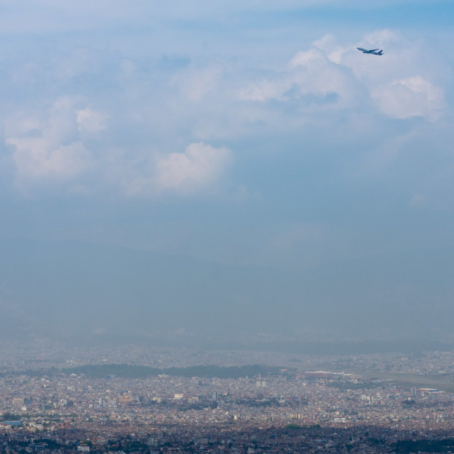 """Airplane over Kathmandu"" stock image"