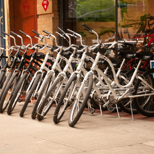 """Row of Bicycles on a City Street"" stock image"