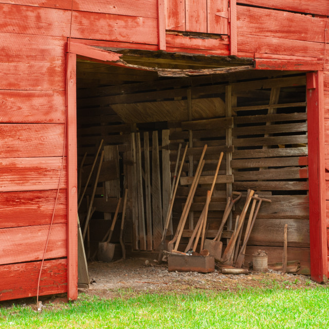 """""""Red Barn and Farming Implements near Dadeville, Alabama"""" stock image"""