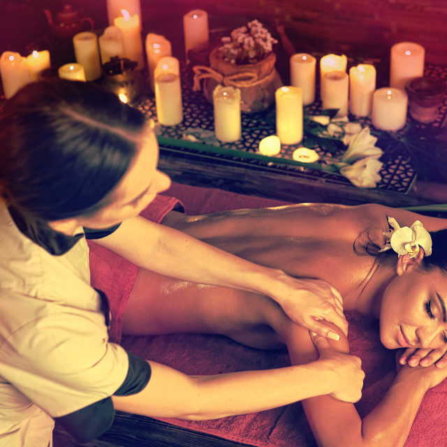 """""""Massage of woman getting rid of cramps in spa"""" stock image"""