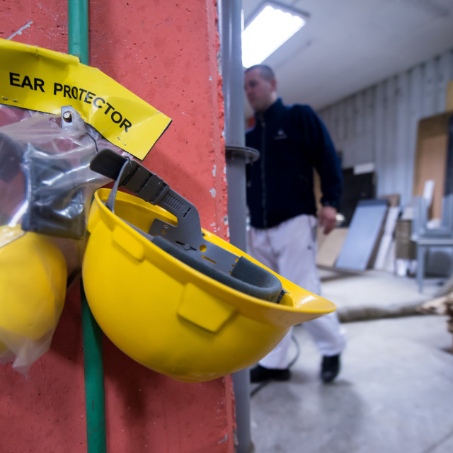 """standard security equipment yellow helmet and ears protection"" stock image"