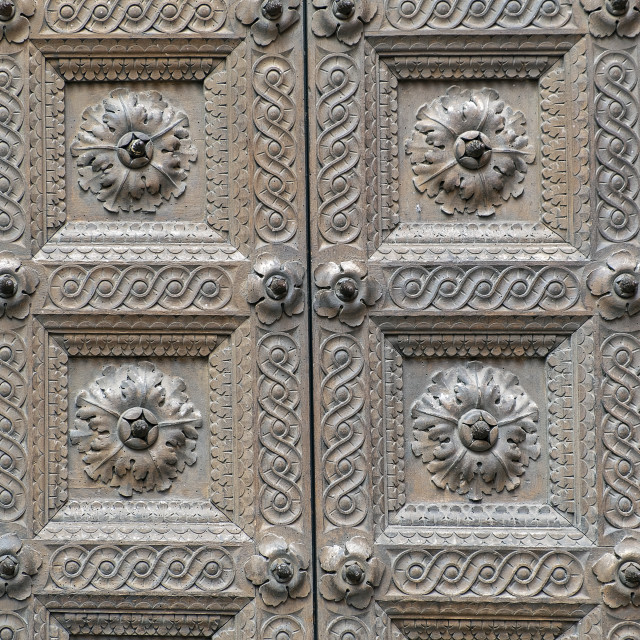 """""""Parma Baptistery wooden gate detail. Color image"""" stock image"""
