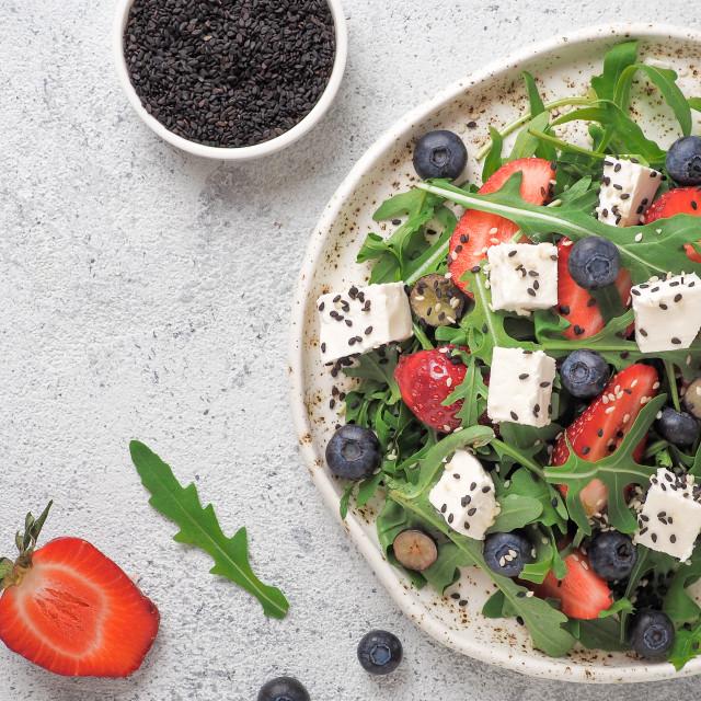 """""""Salad with arugula, feta, strawberry, blueberry"""" stock image"""