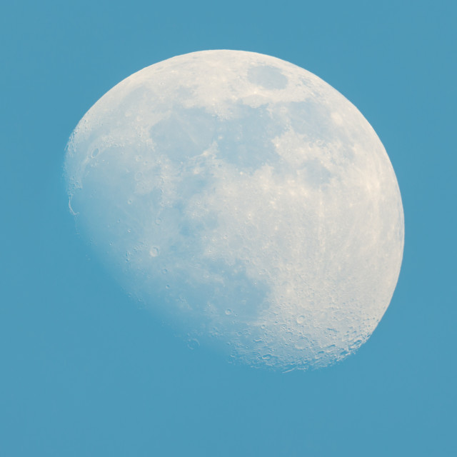 """""""Moon Waxing Gibbous phase on the daytime blue sky"""" stock image"""