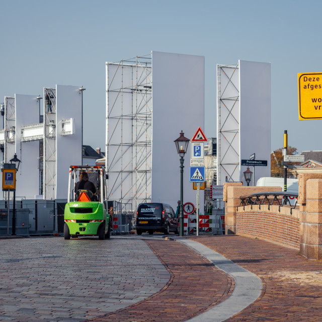 """""""Green forklift truck crossing the bridge in preparation for The"""" stock image"""