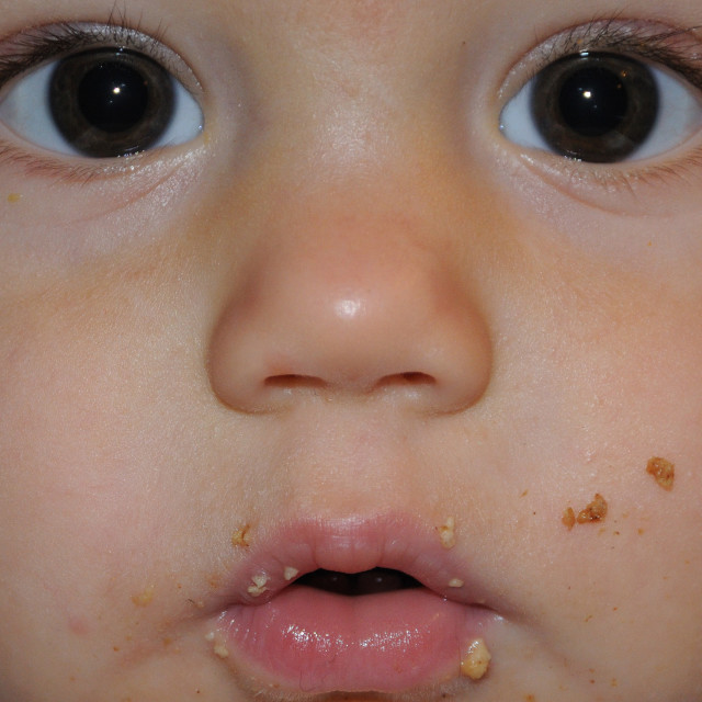 """Messy Baby Face with Food Smeared"" stock image"