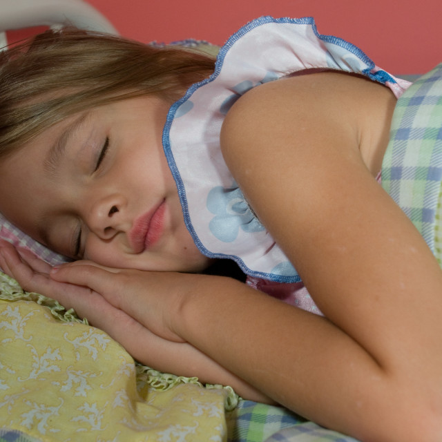 """Little Girl Sleeping in her Bedroom"" stock image"