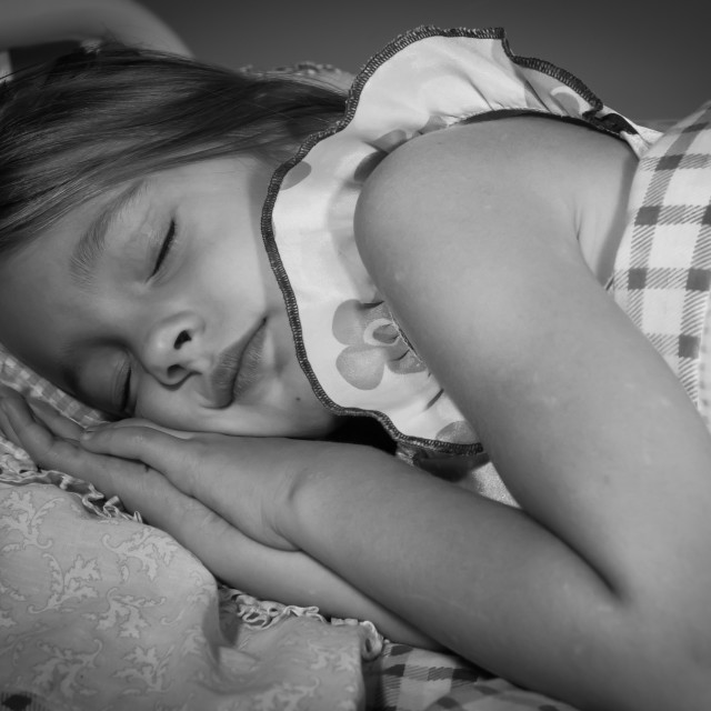 """Little Girl Sleeping in Her Bed"" stock image"