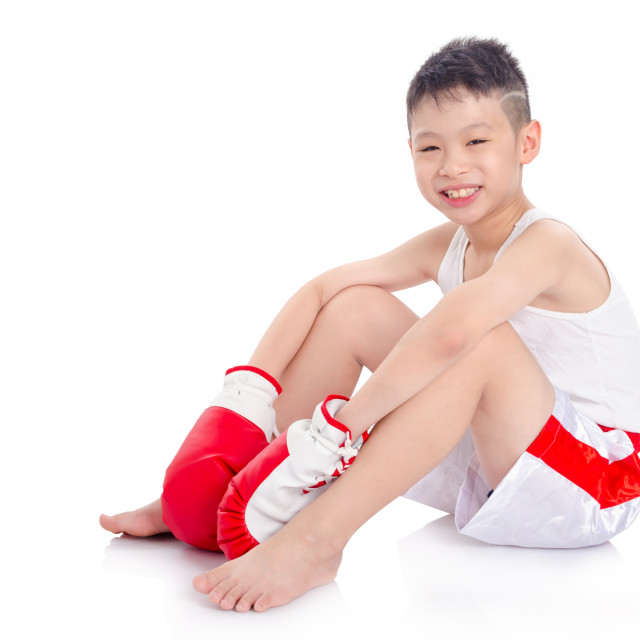 """boxer boy sitting on the floor over white background"" stock image"