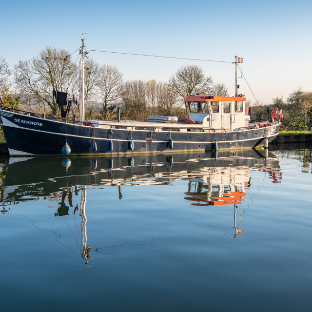 """Boat moored on The Gloucester & Sharpness Canal, Gloucestershire"" stock image"